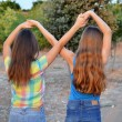 Постер, плакат: Two best friend girls making a forever sign