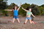 Two best friend girls jumping — Stock Photo