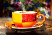 Morning hot coffee on colorful cup — Stock Photo