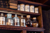 Old pharmacy remedies in glass jars — Stock Photo