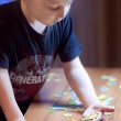 Boy Solving a Puzzle - Education — Stock Photo #45153935