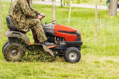 Lawn mower and a man — Stock Photo