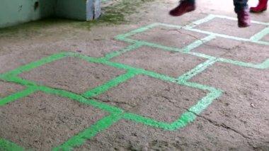Children playing hopscotch on the asphalt — Stock Video
