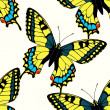 Seamless pattern with colorful machaon butterflies — Stock Vector