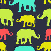 Seamless pattern with colorful silhouette elephants — Stock Vector