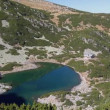 Crystal clear mountain lake and hut from above — Stock Video #49737963