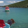 POV of boat leaving bay with crystal waters — Stock Video #50546621