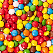 Close up of a pile of colorful chocolate coated candy — Stock Photo