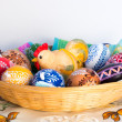 Easter decoration - painted eggs in basket with hen — Stock Photo