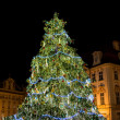 Christmas tree with building in background on Old Town Square — Stock Photo