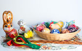 Easter decoration - painted eggs in a basket with other decorations — Foto de Stock
