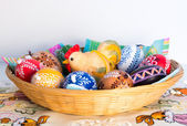 Easter decoration - painted eggs in basket with hen — Стоковое фото
