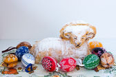 Easter decoration - ram to eat and painted eggs — Стоковое фото