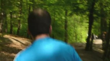 Athlete runs through the forest - steadicam — Wideo stockowe