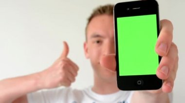 Man with a phone (green screen) - man shows thumbs - man shows phone to camera — Stockvideo