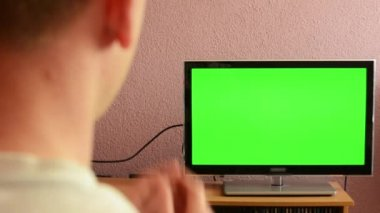 Man watches TV(television) - green screen - man expressed sadness — Stock Video