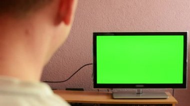 Man watches TV(television) - green screen - man laughs — Stock Video