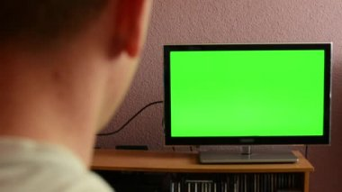 Man watches TV(television) - green screen - discontented man shakes his head and turns off the TV — Stock Video