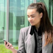 Business woman looks at the mobile before bussines building — Stock Video #46451893