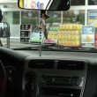 View from inside the vehicle - a man goes to pay for the gas station — Stock Video #47282061