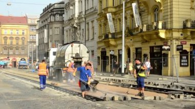 Workers work on the new road with car - with steam — Vídeo de Stock
