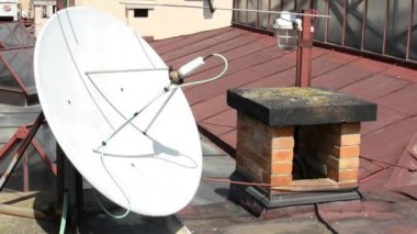 Satellite on the roof with a chimney — Stock Video