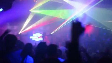 People dancing at a party (disco) - stage lights — ストックビデオ