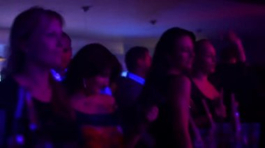 People dancing at a party (disco) - stage lights - attractive woman dancing — Vídeo de Stock