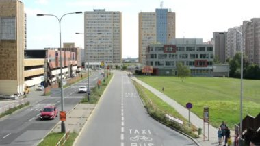 Housing development (high-rise block of flats) with the road - bus stop and grass — Stock Video