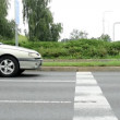 Cars drive on the road - drivers wait on the traffic light — Stock Video #51043161