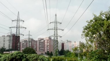 Housing estate with high voltage and trees — Stock Video