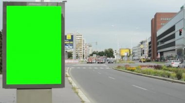 Billboard in the city near road - green screen - building,cars and people — Stock Video
