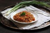 Buckwheat porridge with tomatoes and tomato — Stock Photo