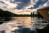 Wooden boat on Rhine river at sunset — Stock Photo