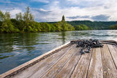 Wooden boat prow on Rhine river — Stock Photo