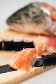 Sushi and salmon head — Foto Stock