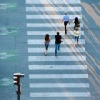 People crossing the street on zebra crossing — Stock Photo #46457029