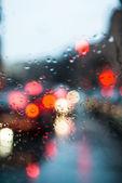 Blurred light through a wet windshield — ストック写真
