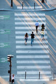 People crossing the street on zebra crossing — Stok fotoğraf