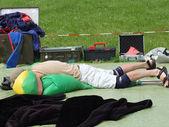 Folding the parachute man lying on a blanket — Stock Photo