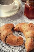 Poppy seed croissant with a cup of coffee — Foto de Stock