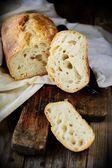 Fresh homemade  bread on a wooden table — ストック写真