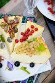 Slice of cheesecake with berries — Stock Photo