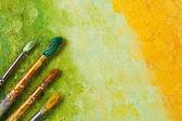 Artists brushes on artistic background — Stock Photo