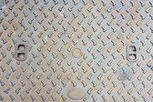 Rustic grunge manhole cover texture — Stok fotoğraf