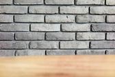 Grey Brick wall with table foreground — Stock Photo