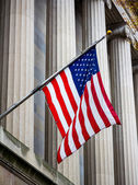 Stars and stripes hanging governmental building — Stock Photo