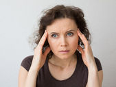 Woman thinking about seriously or with headache — Stock Photo