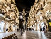 BAKU, AZERBAIJAN - NOVEMBER 22: Nizami street in the center of Baku, Azarbaijan, illuminated by night on the November 22, 2013. The street is known for its exclusive stores and restaurants — Stock Photo