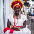 SALVADOR, BRAZIL - JUNE 31: Woman dressed in the traditional clothes of Bahia encourages tourists to enter souvenir shops in Salvador, Brazil on June 31, 2012. Women from Bahia are called Baianas — Stock Photo